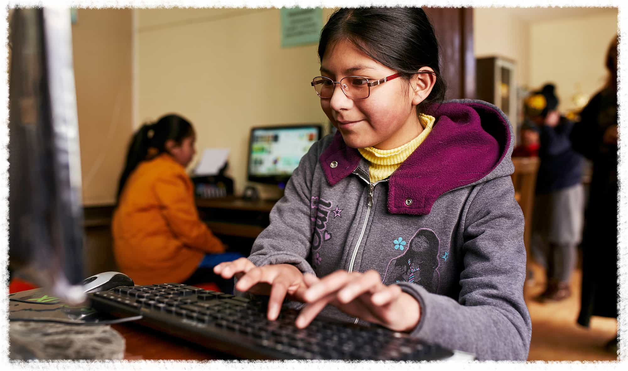 Yhael uses a computer lab at her Compassion center in Bolivia.
