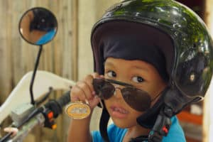 This boy in the Philippines is all dressed up for a motorcycle ride. In countries where Compassion works, it's common to see kids riding on the backs of motorcycles — sometimes with several other people.