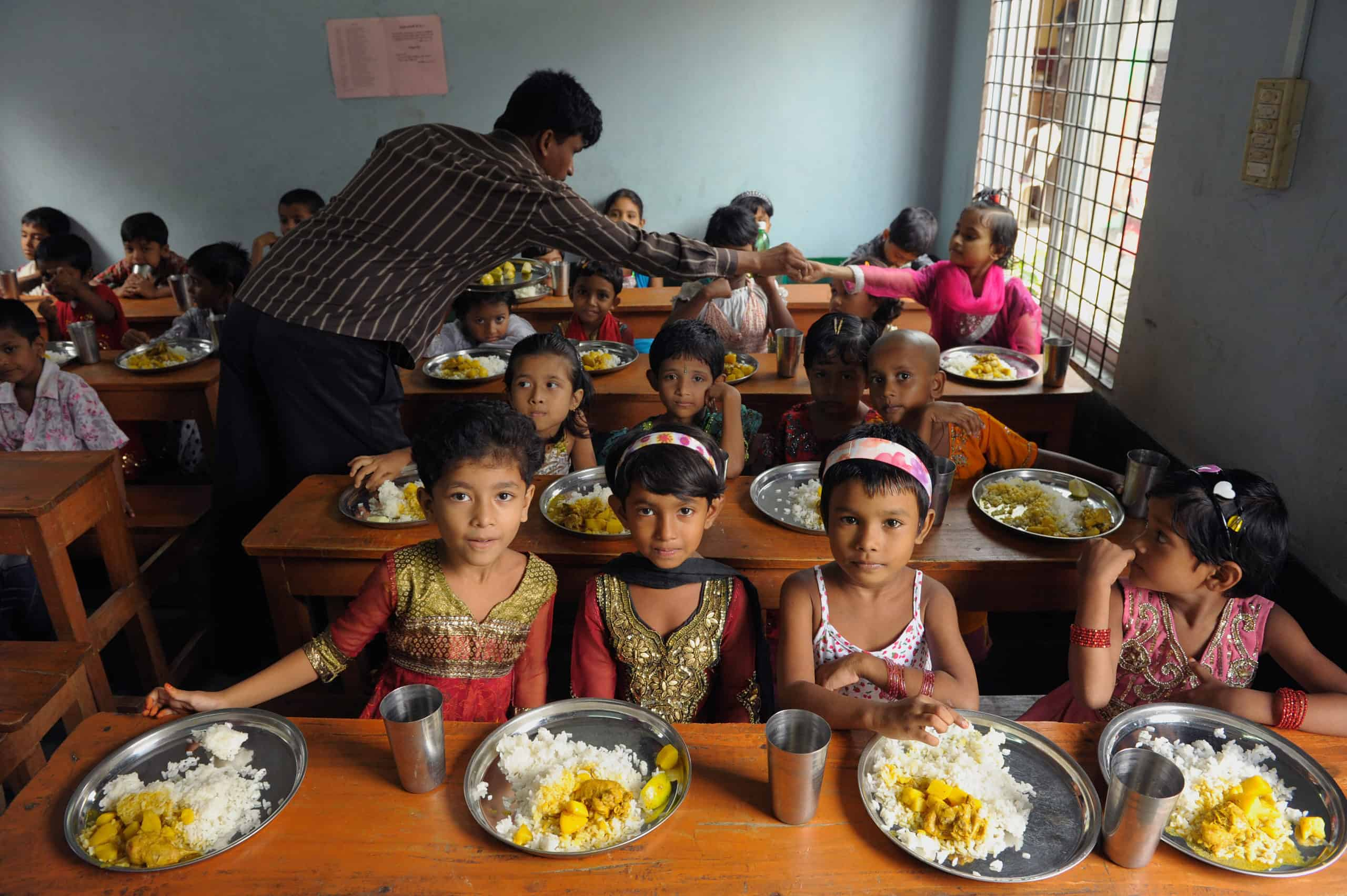 These kids are enjoying a meal at their Compassion center.